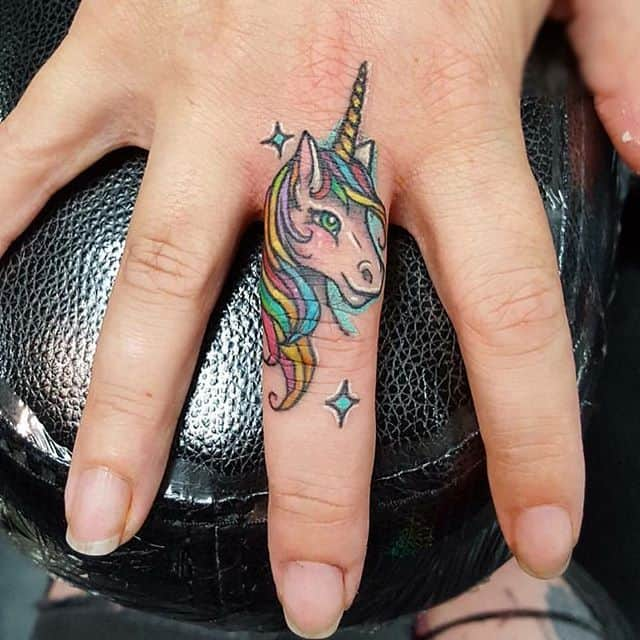 unicorn finger tattoo
