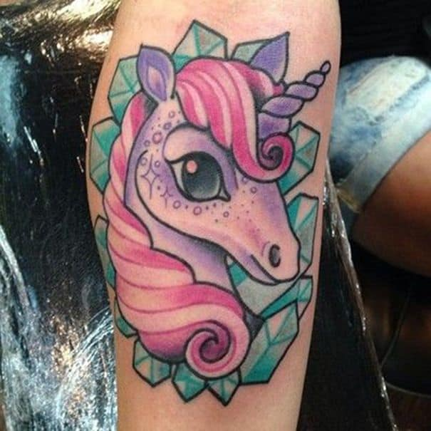 colorful unicorn tattoo on arm