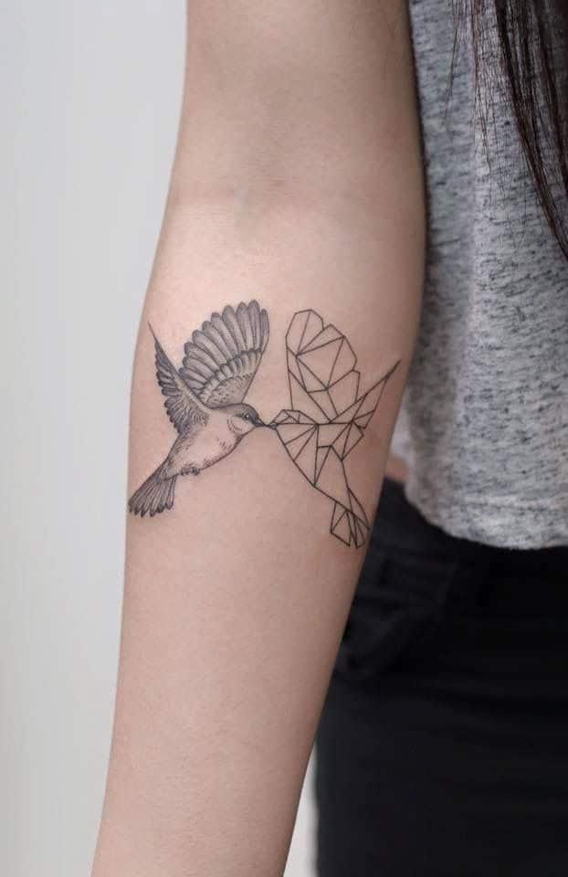 geometric sparrow tattoo on arm