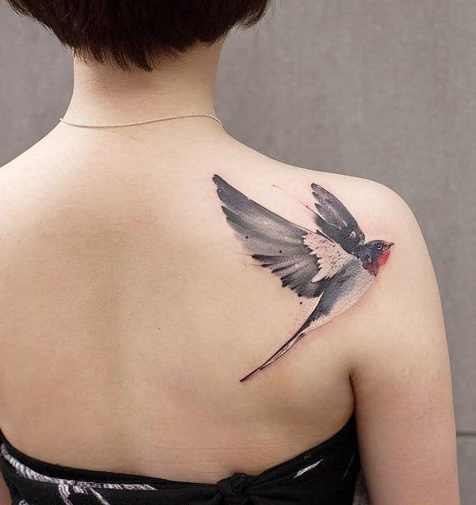 watercolor sparrow tattoo on shoulder