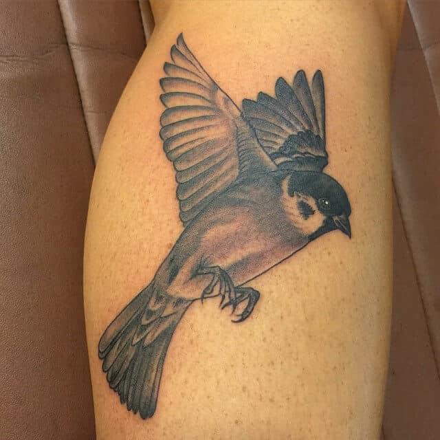 black sparrow tattoo on leg