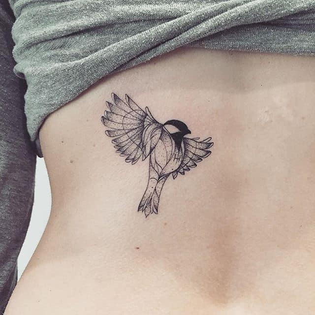 geometric sparrow tattoo on back