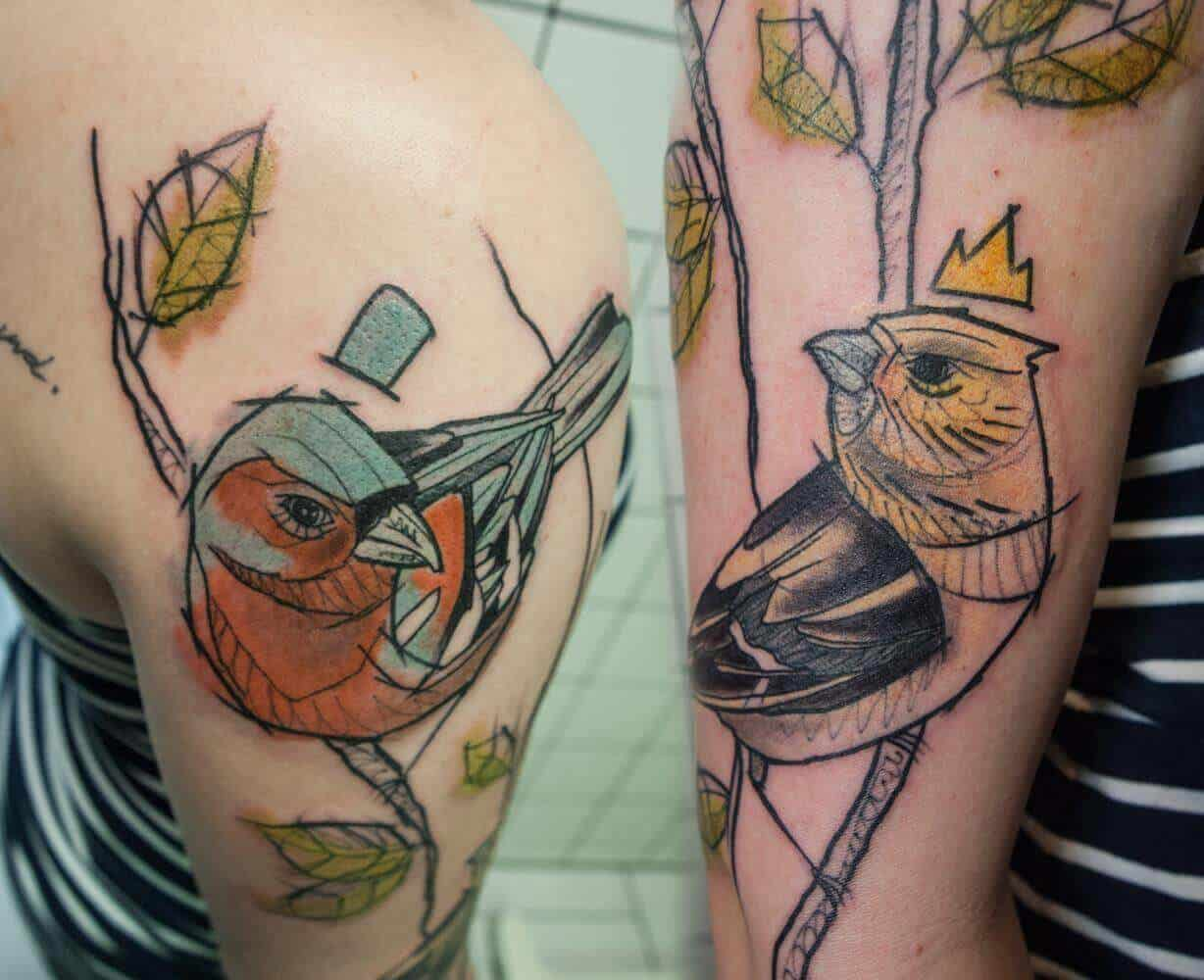 watercolor sparrow tattoo on arm