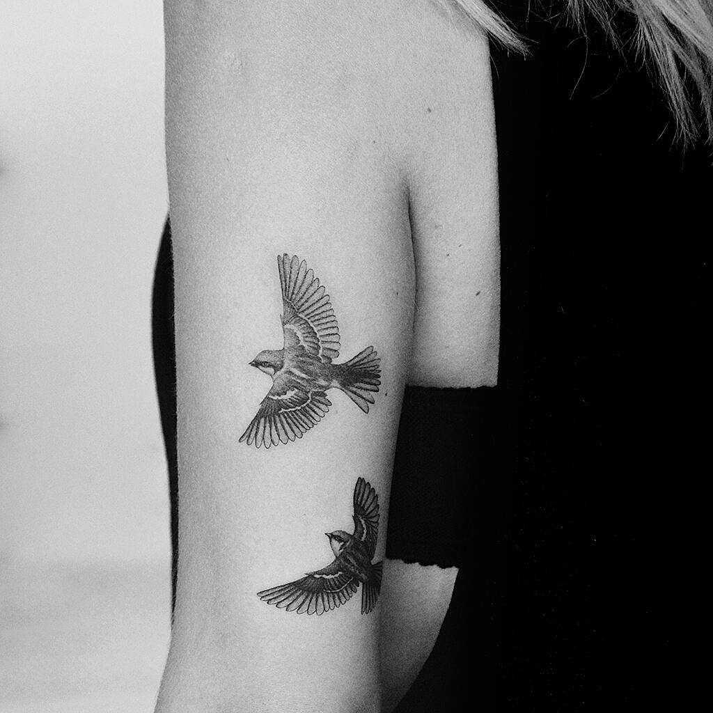 sparrow arm tattoo