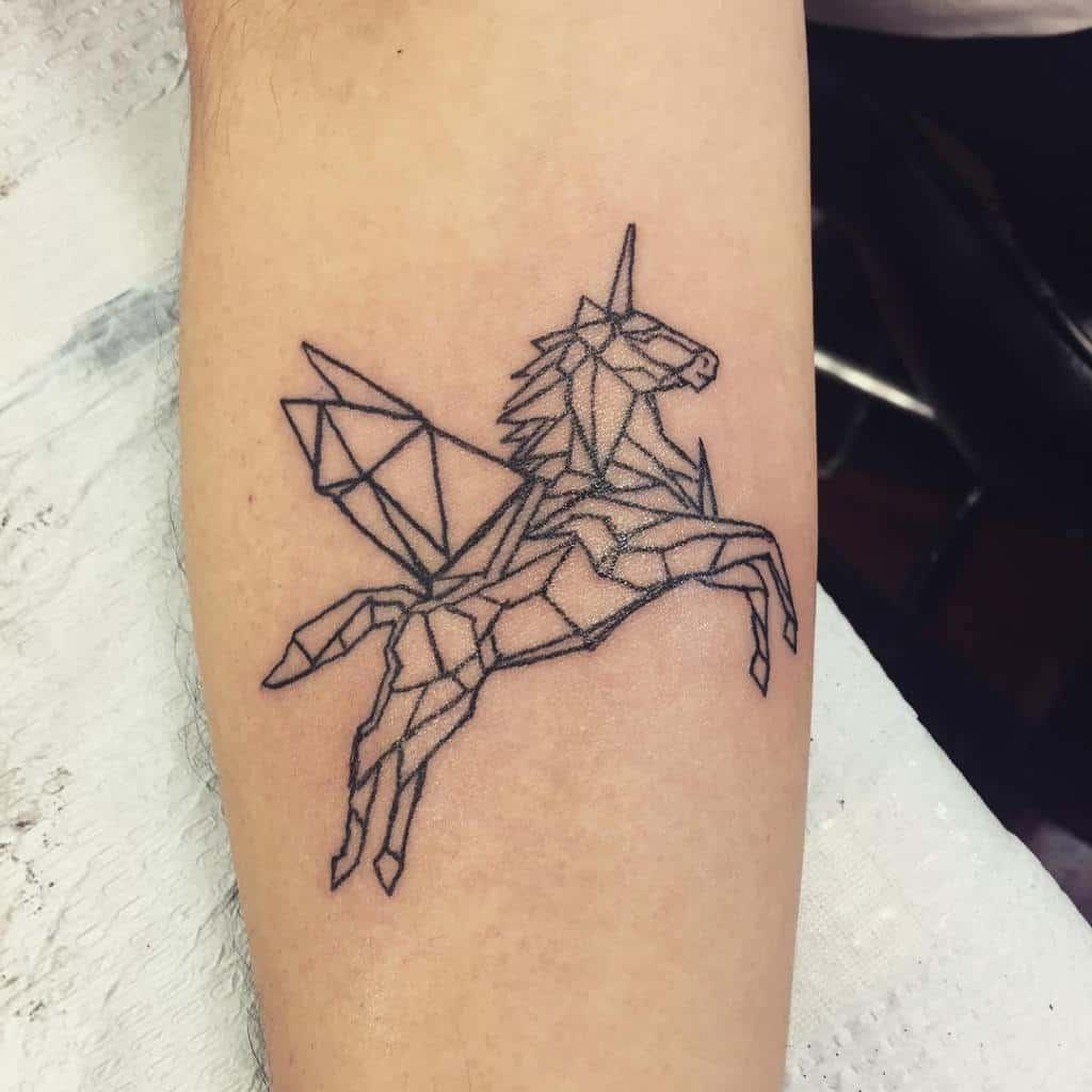 geometric unicorn tattoo on arm