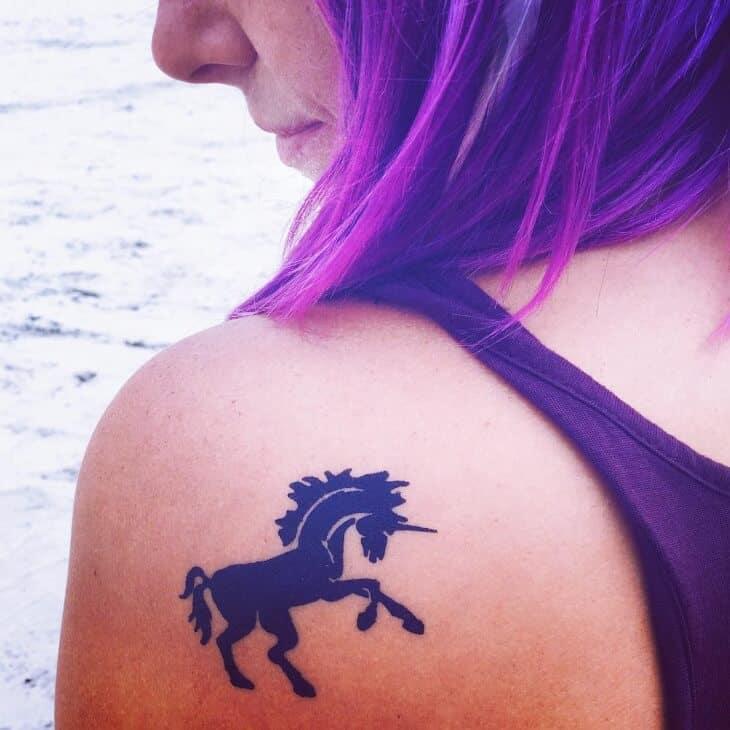 unicorn shoulder tattoo