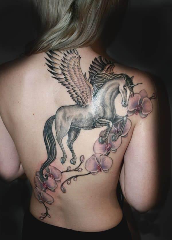 unicorn tattoo on back