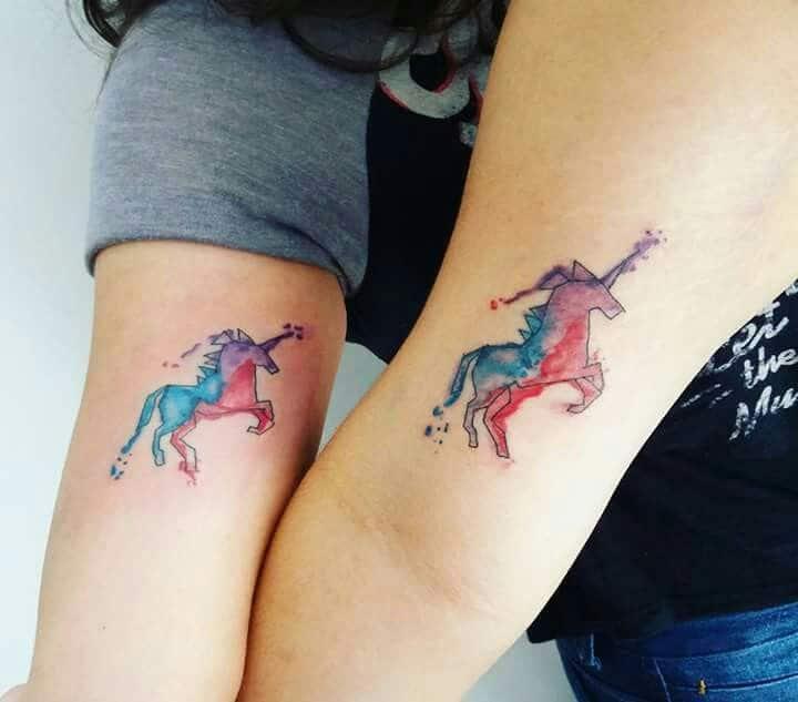 watercolor unicorn tattoo on arm