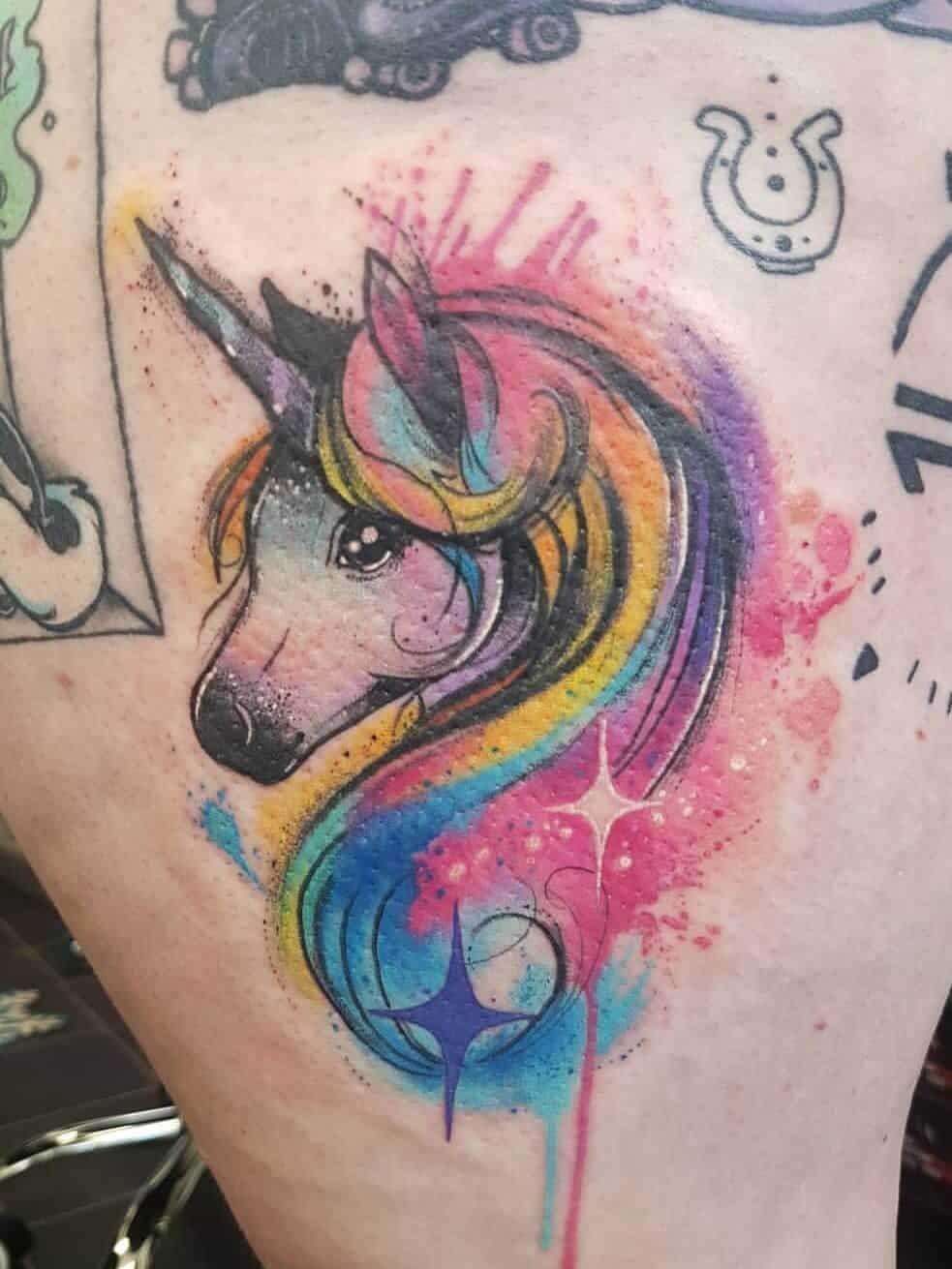 watercolor unicorn tattoo