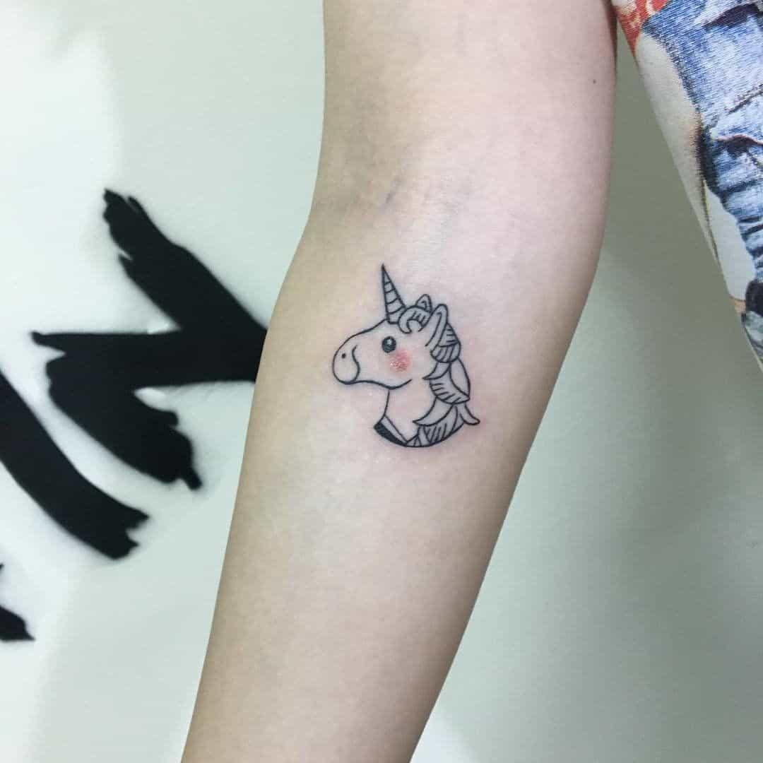 small unicorn tattoo on arm