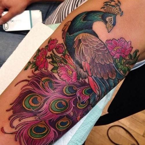 Utterly Stunning Peacock Tattoo On Lower Arm