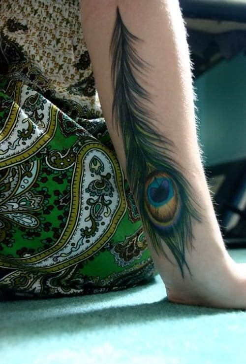 Symbolic Peacock Tattoo On Arm