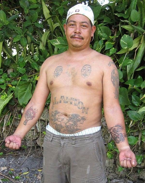 gang member with tattoos