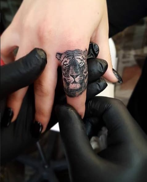 Tiger Finger Tattoo by Cido