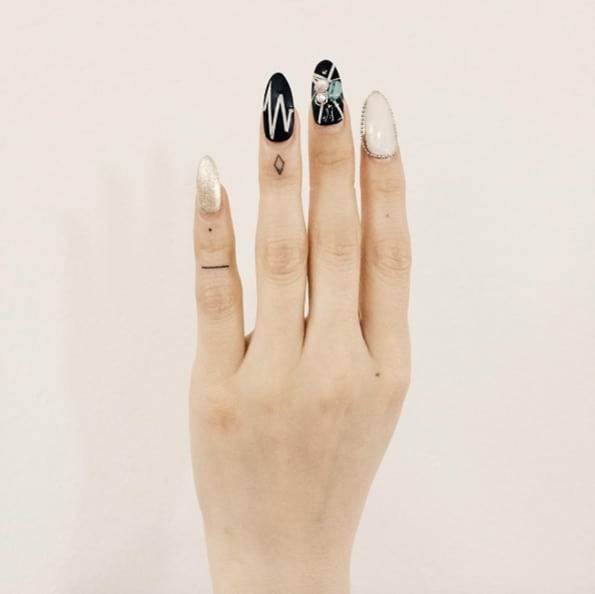 Tiny Finger Tattoos by Doy