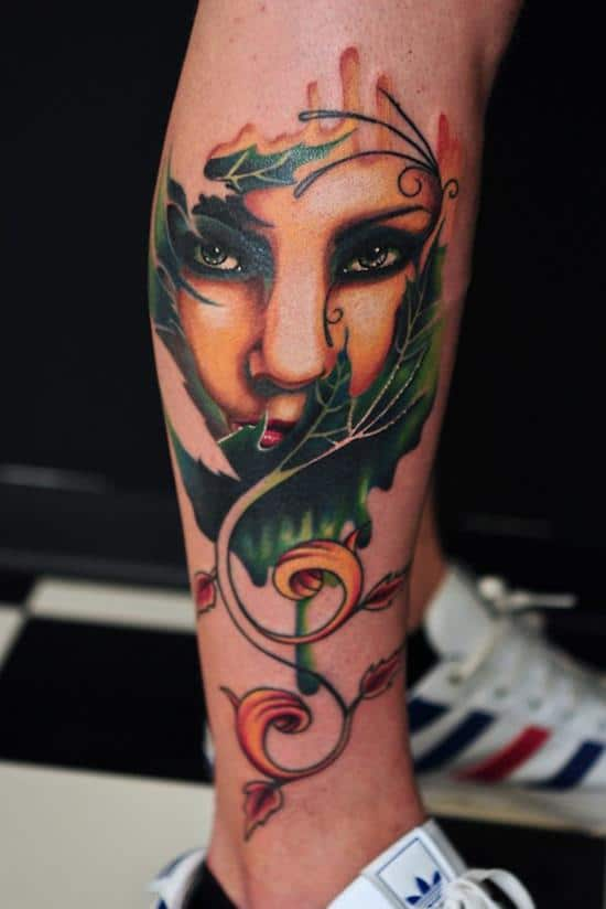 24-woman-in-leaves-leg-tattoo