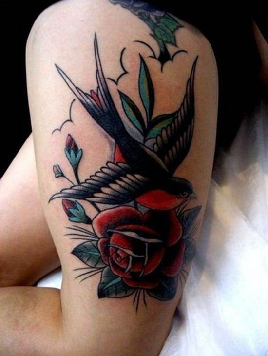 25-swallow-and-rose-thigh-tattoo