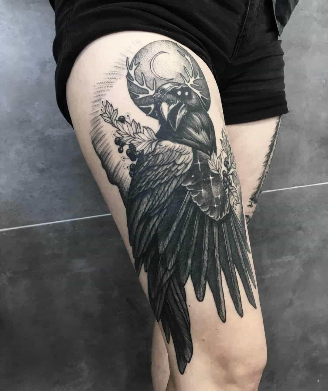 crow raven thigh tattoo