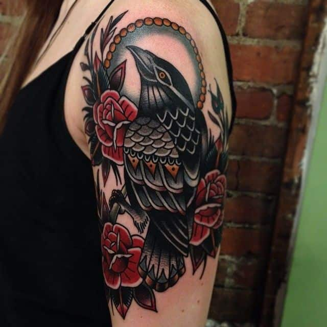 colored crow raven tattoo on arm