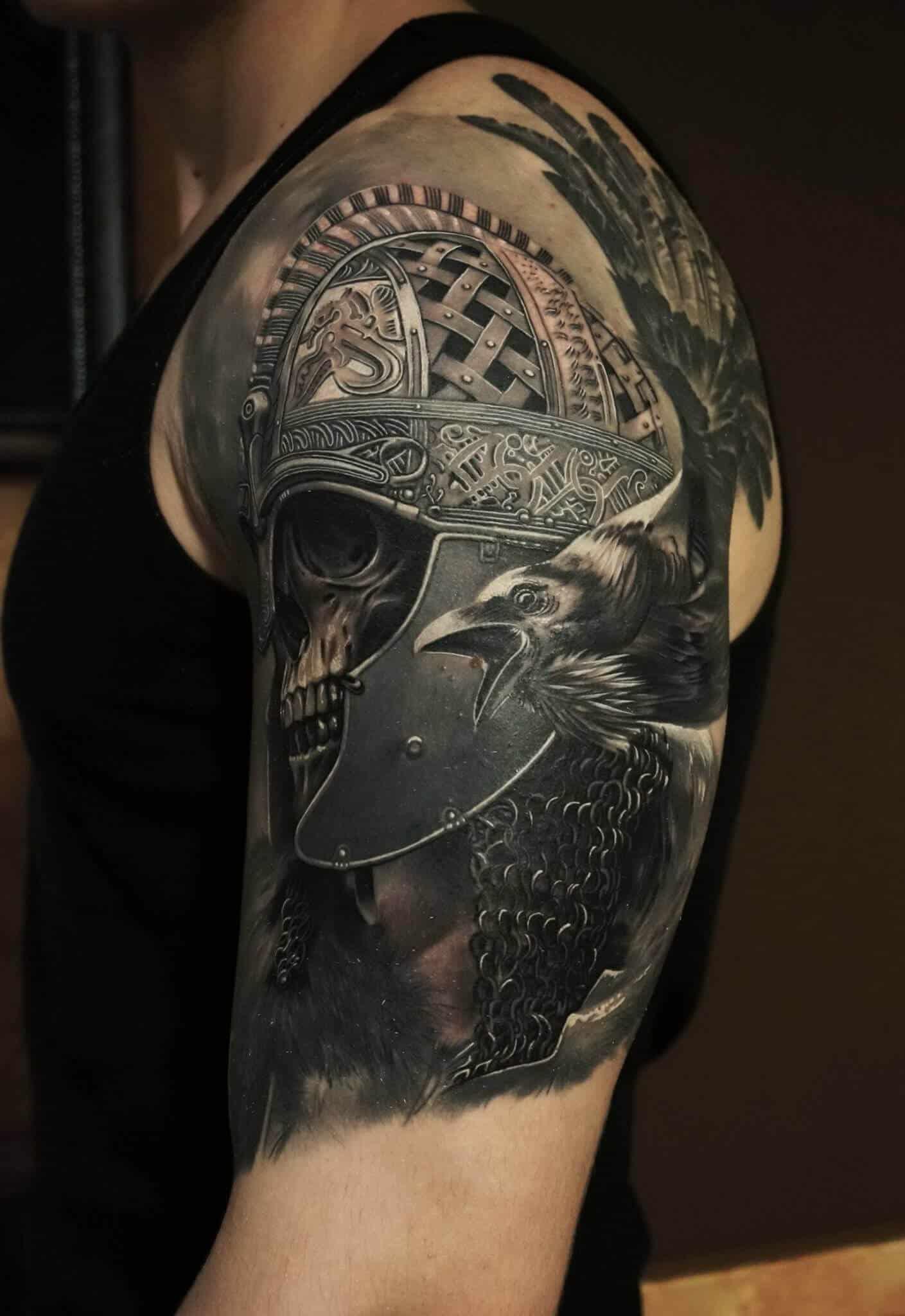 crow raven tattoo on arm