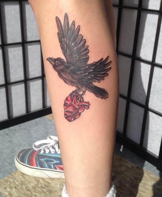 crow raven leg tattoo