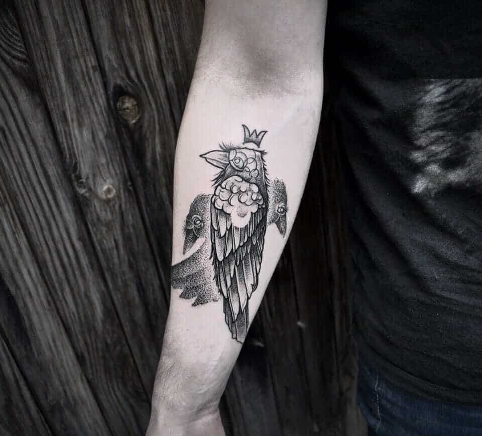 abstract crow raven tattoo on arm