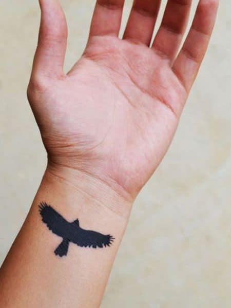 crow raven wrist tattoo