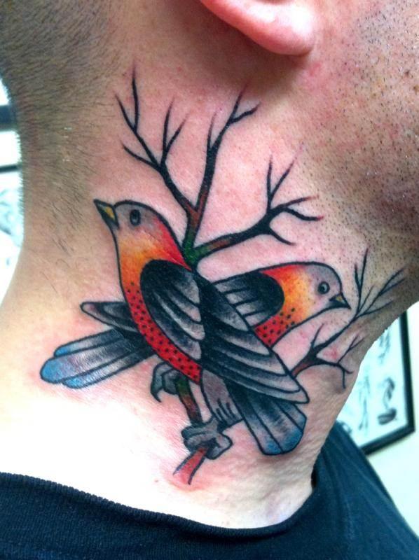 Amazing Bird Tattoo on Neck
