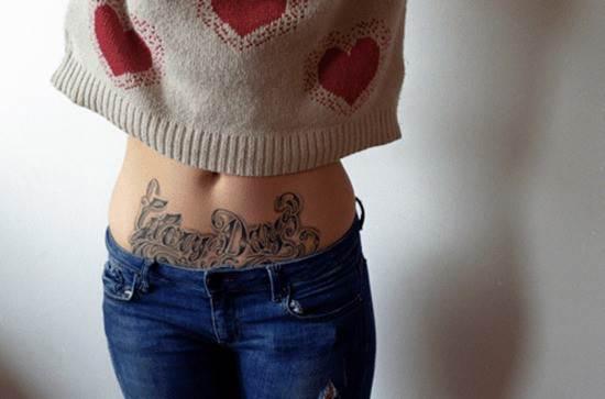 Black-words-stomach-tattoo