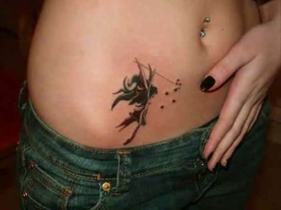 Artistic-fairy-stomach-tattoo
