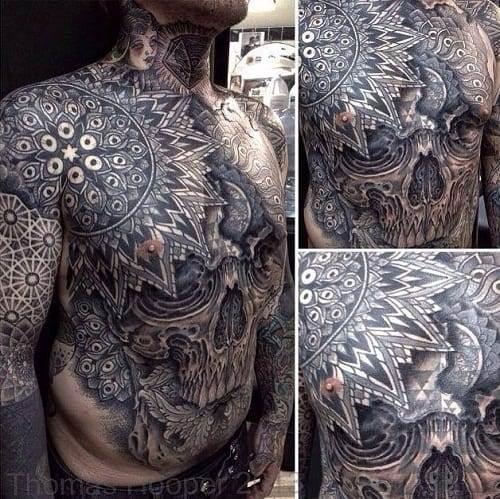 Black Outstanding Skull Tattoo on Stomach