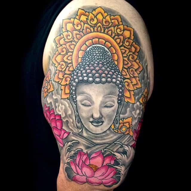 buddha tattoo on upper arm