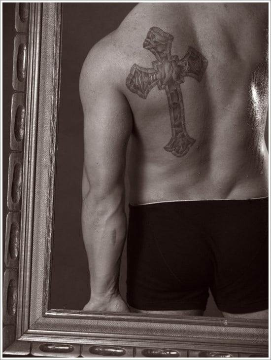 male with cross tattoo in a frame