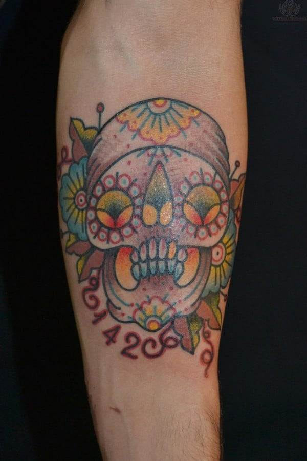 Sugar Skull And Numbering Tattoo On Arm
