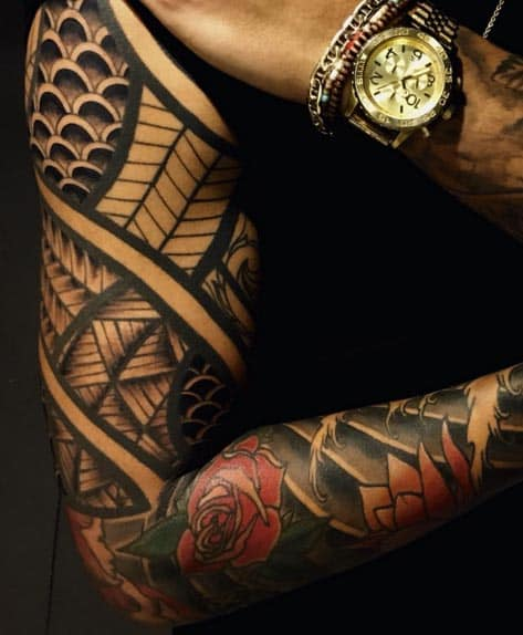 Spiraling Japanese/Tribal Sleeve Tattoo by Christopher Noogin