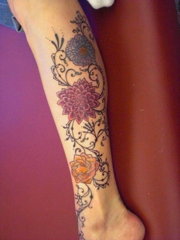 Colourful-dahlia-tattoo-idea-on-calf
