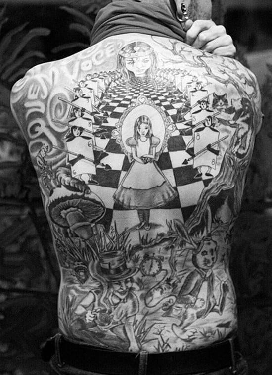 alice in wonderland back tattoo