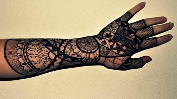 black polynesian tattoo on arm