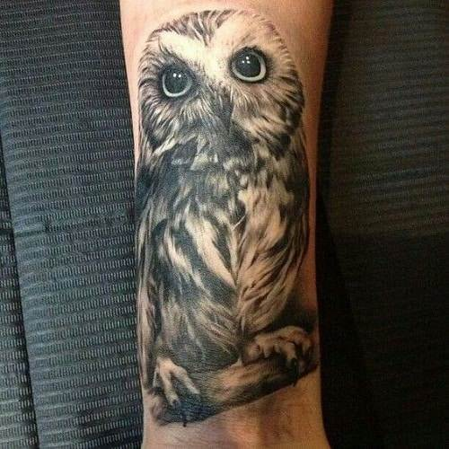 owl tattoo on lower leg