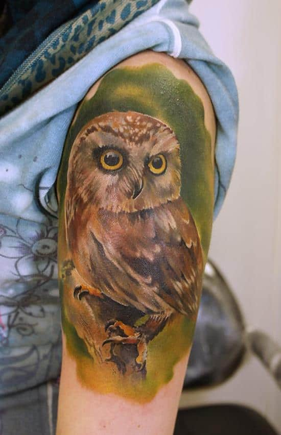 small owl tattoo on shoulder