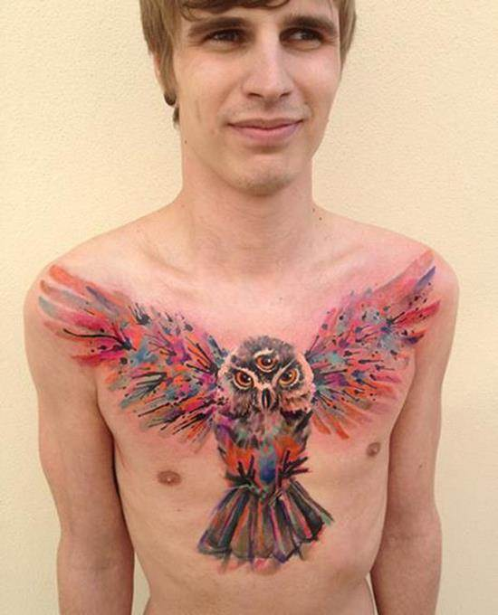Watercolor owl chest tattoo