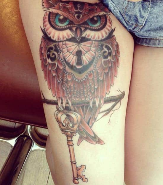 owl and key colored tattoo on thigh girl