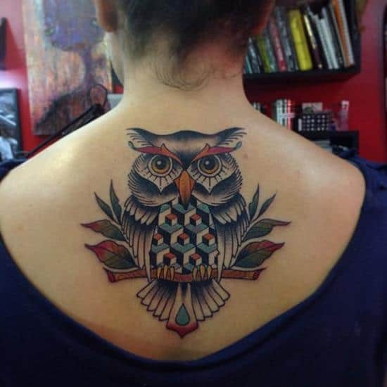 colored owl tattoo on upper back