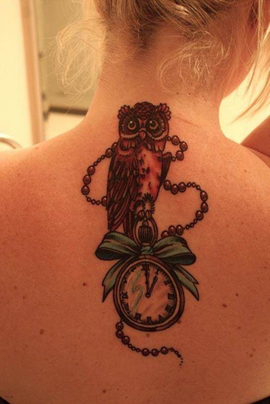clock and owl tattoo on back