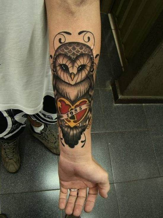 1985 forearm owl tattoo