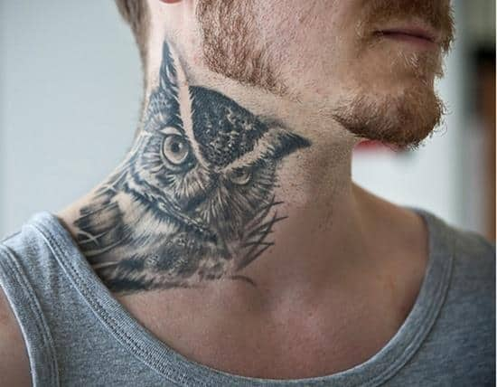 owl face neck tattoo