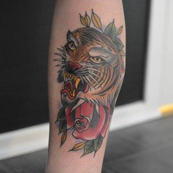 tiger and rose tattoo on arm