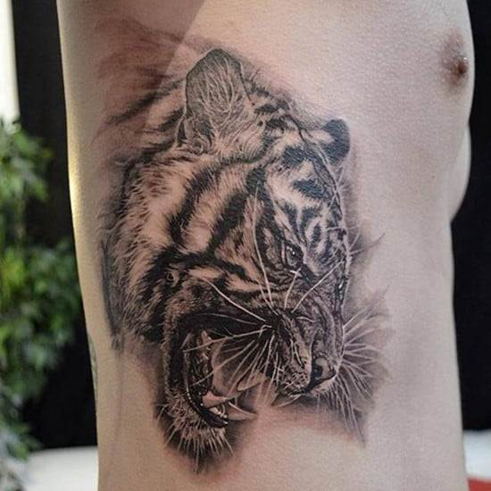tiger on side of ribs tattoo