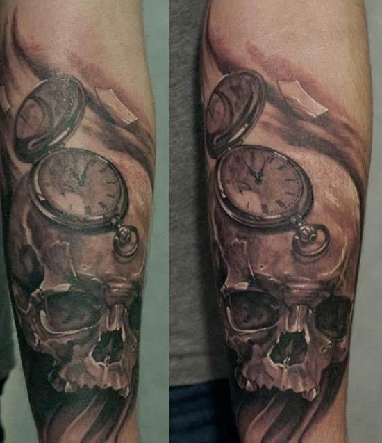 skull and watch arm tattoo