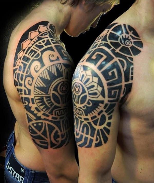 two maori shoulder tattoos